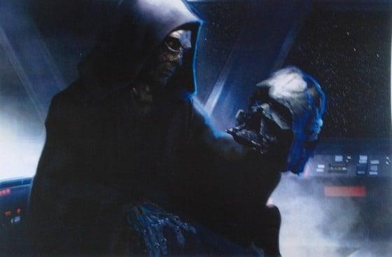 Sydow's character examining Vader's helmet 2